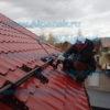 монтаж снегозадержателей на крыше коттеджа